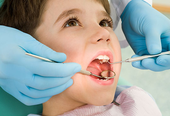 Child at dental clinic