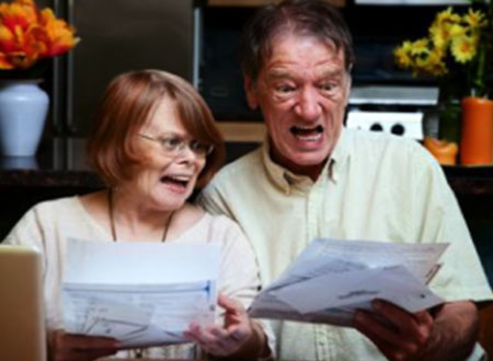 Old couple surprising when looking they bills