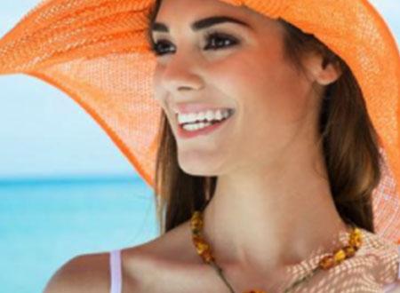 Orange hat wearing girl smiling