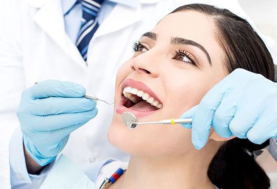 Female patient receiving dental care