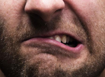 Man teeth grinding