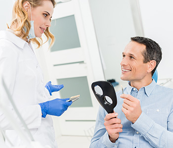 Dentist advices to patient after his dental implant treatment in Tucson, az area
